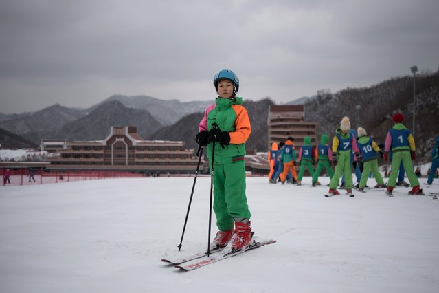 In this photo taken on February 19, 2017, Pak Han-Song, 11, poses for a portrait on a beginner's slope at the Masikryong, or Masik Pass, ski resort near Wonsan.