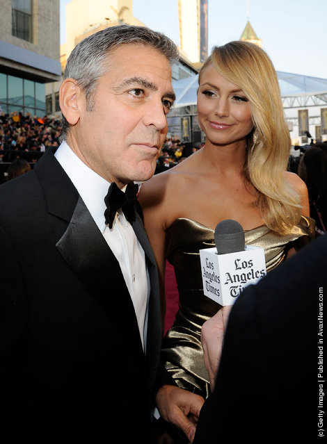 Actor George Clooney (L) and Stacy Keibler arrive at the 84th Annual Academy Awards held at the Hollywood & Highland Center
