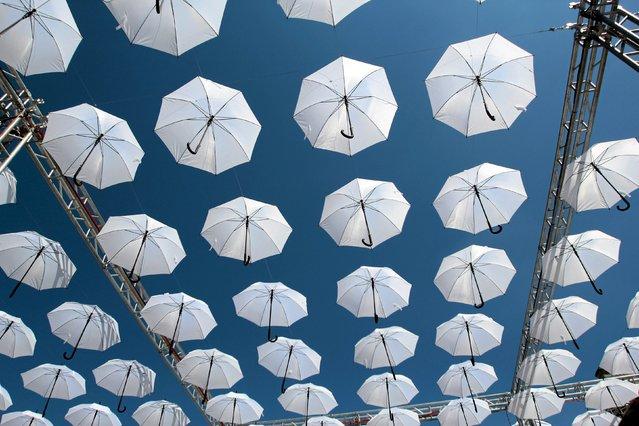Umbrellas hang as a decoration during Carnaval Sztukmistrzow (Mountebanks) festival in Lublin, Poland, July 22, 205. Picture taken July 22, 2015. (Photo by Jakub Orzechowski/Reuters/Agencja Gazeta)