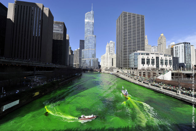 Members of the plumbers' union dye the Chicago River green for St. Patrick's Day on March 17, 2012 in Chicago