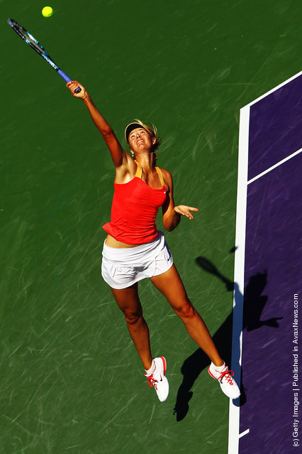 Maria Sharapova of Russia serves to Shahar Peer of Israel during Day 4 of the Sony Ericsson Open at Crandon Park Tennis Center