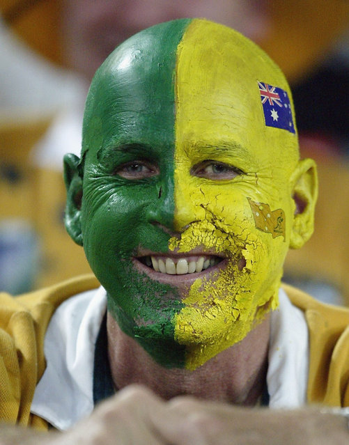 An Australian supporter with a painted face waits for the kick-off of the Rugby World Cup Semi-Final match between Australia and New Zealand at Telstra Stadium November 15, 2003 in Sydney, Australia. (Photo by Stuart Hannagan/Getty Images)