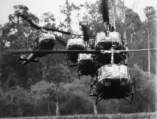 United States Army helicopters land in tight landing formation, near Phouc Vinh, war zone D, South Vietnam, June 20, 1967, during an operation launched by the US Army's 1st Division. (Photo by AP Photo)