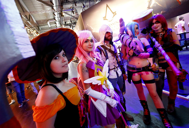 Cosplayers pose for a photo during the Gamescom 2015 fair in Cologne, Germany August 5, 2015. (Photo by Kai Pfaffenbach/Reuters)