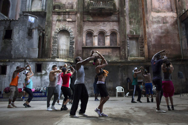 Dancers from the Deep Roots Dance Company perform during a training session in an old theatre in downtown Havana, October 14, 2014. (Photo by Alexandre Meneghini/Reuters)