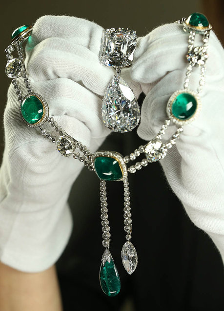 Caroline de Guitaut, Curator of Royal Collections, holds the Cullinan III and IV Broach and the Cullinan VII Delhi Durbar Necklace and Cullinan Pendant at The Queen's Gallery, Buckingham Palace