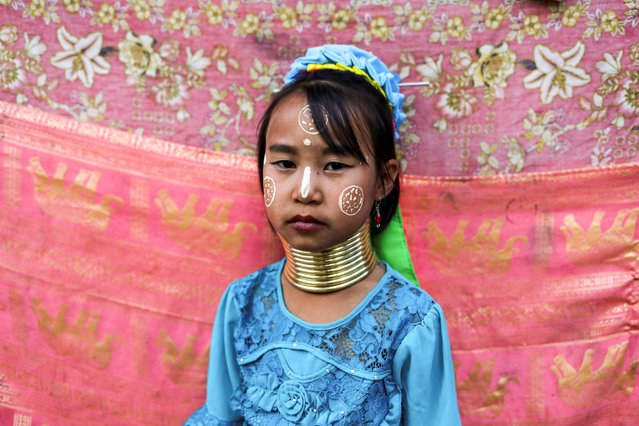 An ethnic Kayan hill tribe refugee girl, also known as long neck woman, poses at her tourist attraction village near Chiang Mai, Thailand on December 23, 2019. (Photo by Jorge Silva/Reuters)