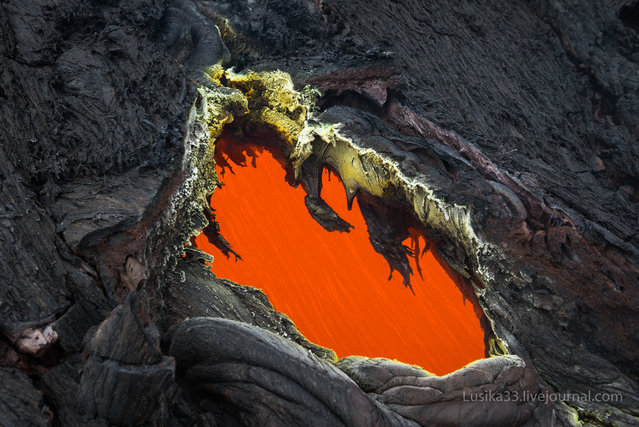 Take a look at this stunning photo of Tolbachik, an active volcanic complex on the Kamchatka Peninsula in far eastern Russia. Lava fountains and rivers ran through the area for months after the eruption began with the opening of two Tolbachik fissures in November of 2012. In the midst of this activity, photographers Luda and Andrey (lusika33) took a trip down to see that stunning hell valley on earth. (Photo by lusika33)