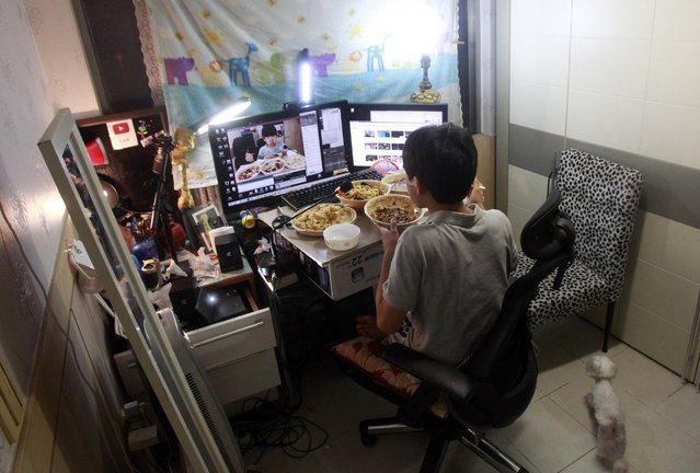 In this Monday, August 17, 2015 photo, Kim Sung-jin, 14, broadcasts himself eating delivery Chinese food in his room at home in Bucheon, south of Seoul, South Korea. (Photo by Julie Yoon/AP Photo)