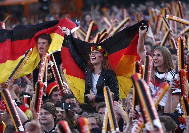 Fans of Germany cheer before the Euro 2016 match between France and Germany in France at a public screening of the match in Berlin, Germany, July 7, 2016. (Photo by Hannibal Hanschke/Reuters)