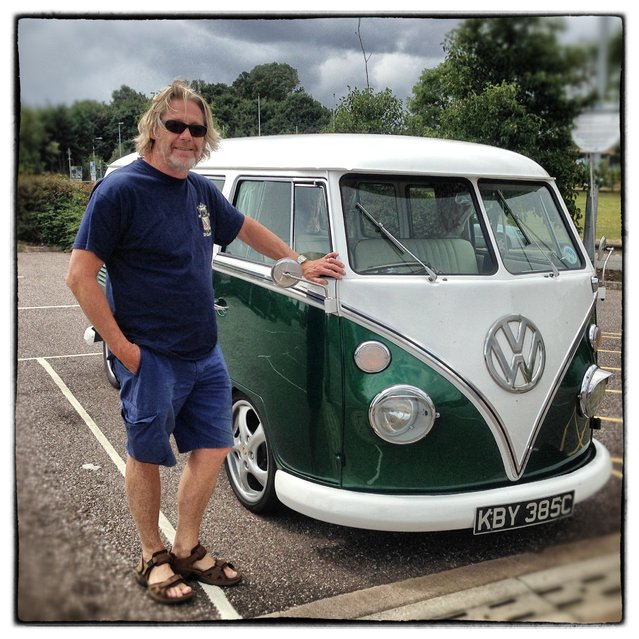Daniel Vosloo from Hertfordshire poses for a photograph besides his 1965 first generation or T1, split-screen Volkswagen Transporter van on August 4, 2014 in Exeter, England. The van, which is nicknamed Zippy and was originally from South Africa now has a Porshe 911 engine fitted. (Photo by Matt Cardy/Getty Images)