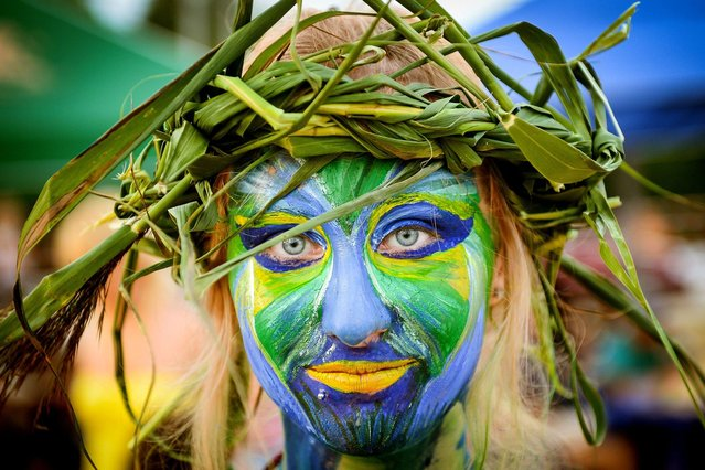 A woman with painted face takes part in the Mermaid festival in city of Braslav, some 270 km from Minsk on August 8, 2014. (Photo by Maksim Malinovsky/AFP Photo)