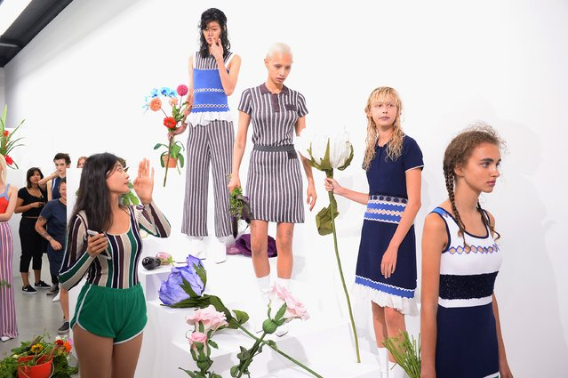PH5 fashion designer Mijia Zhang (L) and models prepare during the PH5 Presentation at New York Fashion Week on September 6, 2017 in New York City. (Photo by Andrew Toth/Getty Images for PH5)