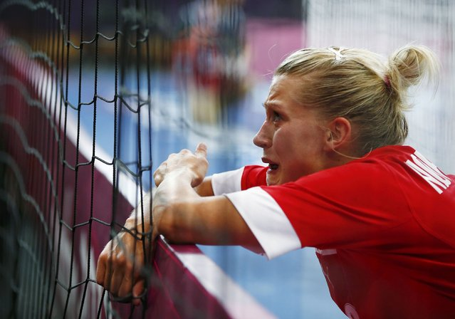 Denmark's Ann Grete Norgaard cries after their loss to Norway in their women's handball Preliminaries Group B match at the Copper Box venue during the London 2012 Olympic Games August 3, 2012. (Photo by Marko Djurica/Reuters)