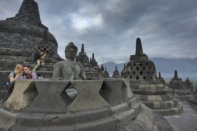 Foreign tourists visit Borobudur Temple in Magelang, Central Java, Indonesia, June 29, 2015 in this file photo taken by Antara Foto. Indonesia is expected to announce tourist arrivals in July this week. (Photo by Andreas Fitri Atmoko/Reuters/Antara Foto)