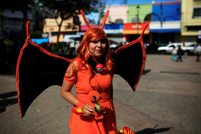 """Cosplayer dressed as a character of the augmented reality mobile game """"Pokemon Go"""" by Nintendo participate in a """"poketour"""" organized by the municipality in San Salvador, El Salvador July 23, 2016. (Photo by Jose Cabezas/Reuters)"""