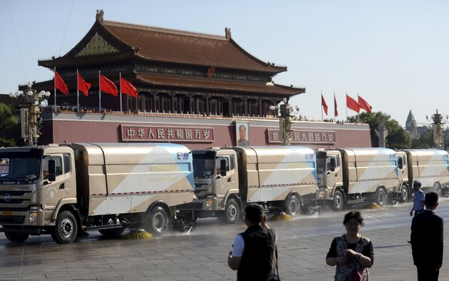 Cleaning vehicles wash the floor as they drive past the Tiananmen Gate ahead of a military parade to mark the 70th anniversary of the end of World War Two, in Beijing, China, September 3, 2015. (Photo by Reuters/Stringer)
