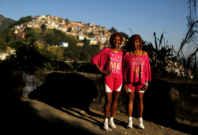 """Silvana Batista (L), a 49-year-old retired nurse, poses with her mother, Helena Batista, in Rio de Janeiro, Brazil, July 12, 2016. Silvana and Helena are fearful and live in a slum that is in a constant battle between gangs. When they were asked about the Olympics in Rio de Janeiro, they said, """"We are living in hard and violent times in the city, we are concerned that all the security on the streets could not be enough"""". They also hope the event will be a success and people who come to the city will have the best experience. (Photo by Pilar Olivares/Reuters)"""