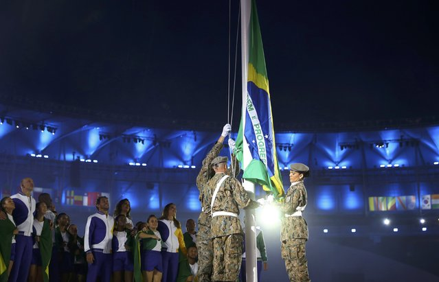 2016 Rio Olympics, Opening ceremony, Maracana, Rio de Janeiro, Brazil on August 5, 2016. The Brazilian national flag is raised during the opening ceremony. (Photo by Kai Pfaffenbach/Reuters)
