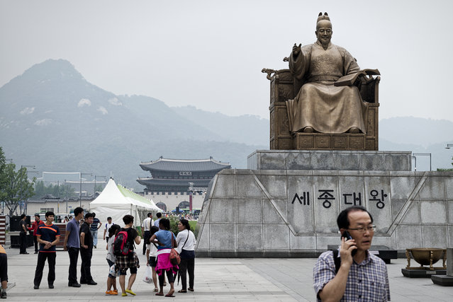 The statue of Sejong the Great is seen at Gwanghwamun Square, and behind the statue, Bugaksan Mountain, Cheongwadae the Presidential Mansion and Gwanghwamun are seen on July 29, 2015 in Seoul, South Korea. Sejong the Great (May 15, 1397-April 8, 1450, r. 1418-1459) was the fourth king of Joseon Dynasty, and one of his many achievement is the creation and introduction of Hangul, the native alphabet system for the Korean language. (Photo by Shin Woong-jae/The Washington Post)