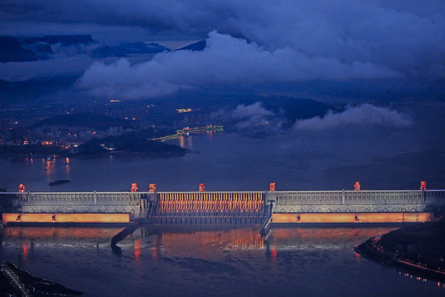 A night view of the illuminated Three Gorges Dam on October 17, 2017 in Yichang, Hubei Province of China. Various lamps were installed at Three Gorges Dam to increase its night charm. (Photo by VCG/VCG via Getty Images)