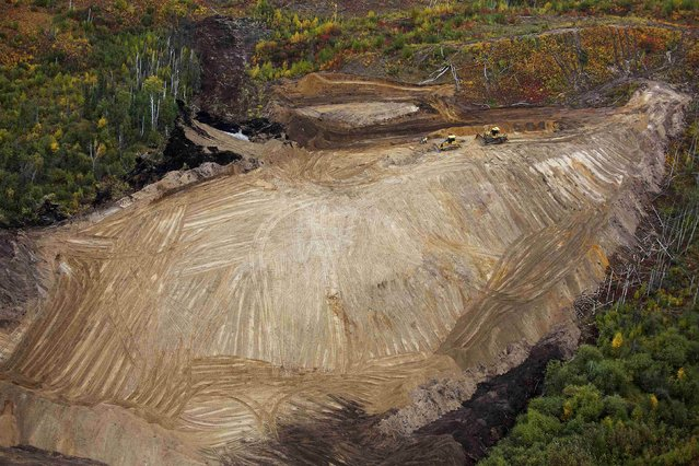 Bulldozers work clearing an area at the new Suncor Fort Hills tar sands mining operations near Fort McMurray, Alberta, September 17, 2014. (Photo by Todd Korol/Reuters)