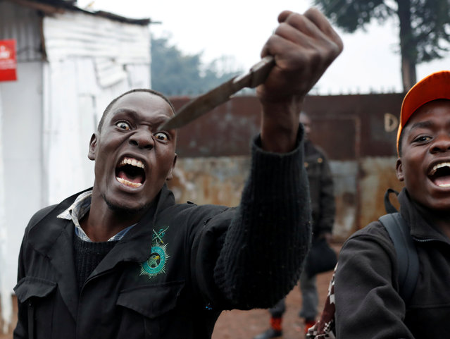 An opposition supporter gestures with a knife during clashes with police in Kibera slum in Nairobi, Kenya October 26, 2017. (Photo by Goran Tomasevic/Reuters)
