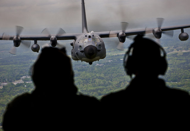 Aircrew members admire their MC-130E Combat Talon during the plane's final flight before retirement. The last five MC-130s in the Air Force belong to the 919th Special Operations Wing at Eglin Air Force Base, Fla. (Photo by USAF)