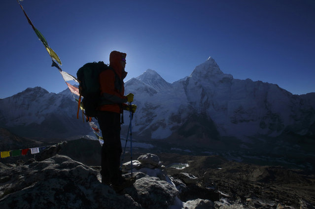 A trekker stands in front of Mount Everest, which is 29035 feet high, at Kala Patthar in Solukhumbu District May 7, 2014. (Photo by Navesh Chitrakar/Reuters)