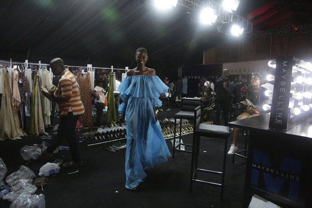 A model is seen backstage during the Fashion and Design Week in Lagos, Nigeria, Friday, October 27, 2017. (Photo by Sunday Alamba/AP Photo)