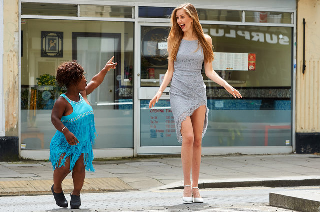 One of the worlds shortest models Mary Russell at 4 feet 1 inch with 6 foot model Georgia Meacham in London, UK on June 16, 2016. The 4ft1 beauty suffers with achondroplasia  a medical term for dwarfism, which means she has as average sized torso but short arms and short legs, with an oversized head. As well as stifled growth, Mary also suffers with sciatica and spinal stenosis, an abnormal narrowing of the spinal canal – which cause agonising nerve problems, leaving her in excruciating pain and unable to stand for long periods of time. The condition leaves Mary, 47, struggling with everyday tasks  things most people take for granted like going to the supermarket, getting cash from an ATM and ordering a drink at a bar become a challenge. (Photo by Simon Jacobs/Caters News Agency)