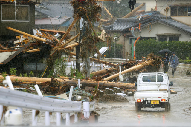 Debris are seen on a residential area hit by heavy rain in Kumamura, Kumamoto prefecture, southern Japan Tuesday, July 7, 2020. Rescue operations continued and rain threatened wider areas of the main island of Kyushu. (Photo by Kota Endo/Kyodo News via AP Photo)