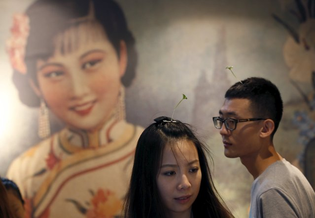 A couple wearing sprout-like hairpins look around a shop  in Beijing, China, September 25, 2015. (Photo by Kim Kyung-Hoon/Reuters)