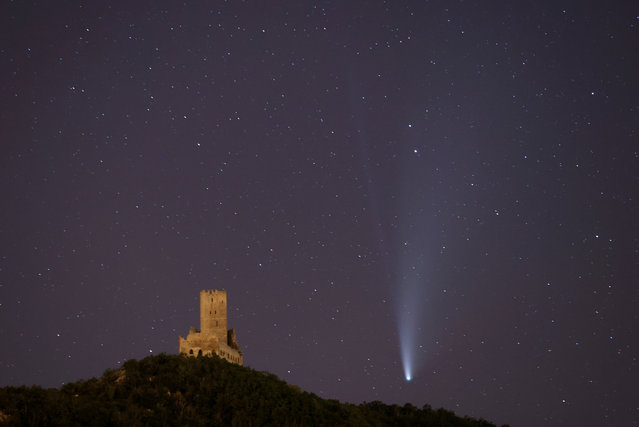 "The Comet C/2020 or ""Neowise"" is seen in the sky over Ortenbourg castle, near Scherwiller, France early July 20, 2020. (Photo by Christian Hartmann/Reuters)"