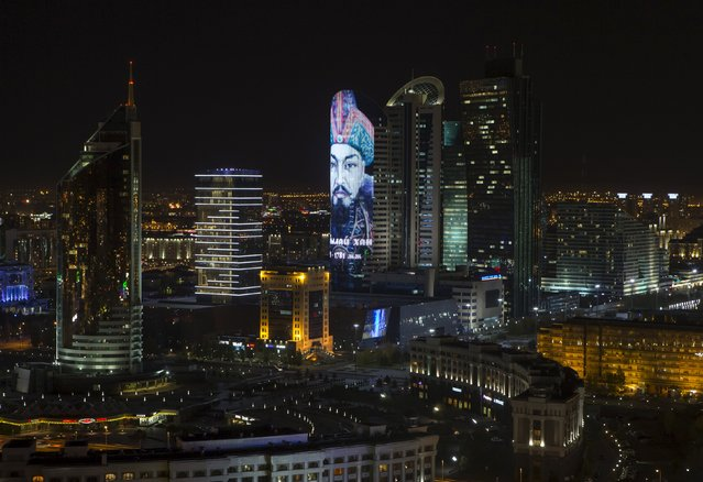 A portrait of Kazakh historical figure Ablai Khan is projected on a building in downtown Astana, Kazakhstan, October 8, 2015. (Photo by Shamil Zhumatov/Reuters)