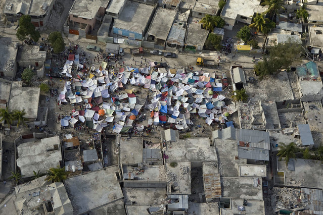 Makeshift tents are seen after an earthquake on January  13, 2010 in Port-au-Prince, Haiti. (Photo by Logan Abassi/MINUSTAH via Getty Images)