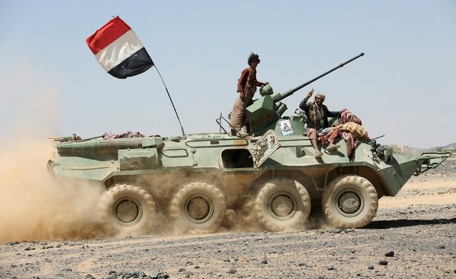 Fighters of the Popular Resistance Committees ride on an armoured vehicle as they carry their weapons during a military parade at the area Al-Gevinh in the central province of Marib October 10, 2015. (Photo by Reuters/Stringer)