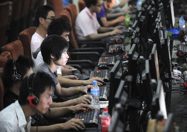 Customers at an internet cafe in Hefei, Anhui province. (Photo by Jianan Yu/Reuters)
