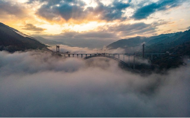 The major construction of maximum span railway arch bridge has been finished in Baoshan, Yunnan, China on December 30, 2019. The Lancang River Railway Bridge is an arch bridge connecting the cities of Baoshan and Dali. Once completed, the bridge will be one of the highest in world at 271m (889 ft) above the Lancang River. The bridge's main span will be 342 m (1,122 ft) making it also one of the longest arch bridges ever built. (Photo by Top Photo Corporation/Rex Features/Shutterstock)