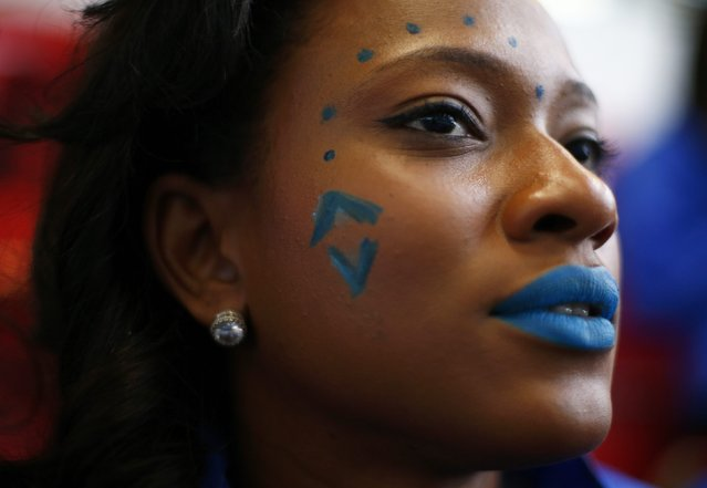Miss U.S. Virgin Islands Aniska Tonge wears face paint during the Miss World sports competition at the Lee Valley sports complex in north London, November 26, 2014. (Photo by Andrew Winning/Reuters)