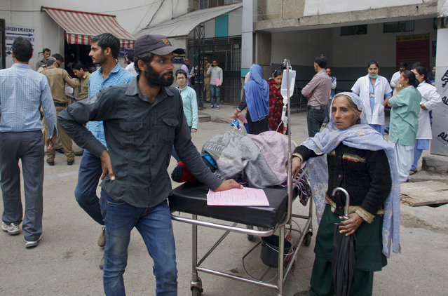Patients who were shifted outdoors at the government medical college hospital after a strong tremor was felt in Jammu, India, Monday, October 26, 2015. (Photo by Channi Anand/AP Photo)