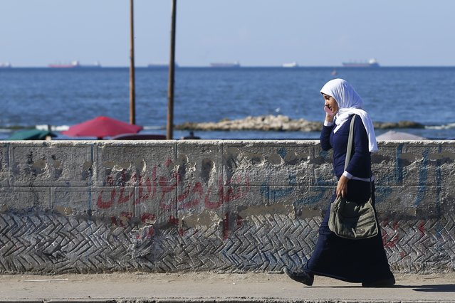 A student walks over a bridge after school near the fishermen's village in El Max in the Mediterranean city of Alexandria October 18, 2014. (Photo by Amr Abdallah Dalsh/Reuters)