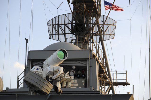 The laser weapon system (LaWS) is tested aboard the USS Ponce amphibious transport dock during  an operational demonstration while deployed in the Gulf in this November 15, 2014 U.S. Navy handout photo provided December 11, 2014. (Photo by John Williams/Reuters/U.S. Navy)