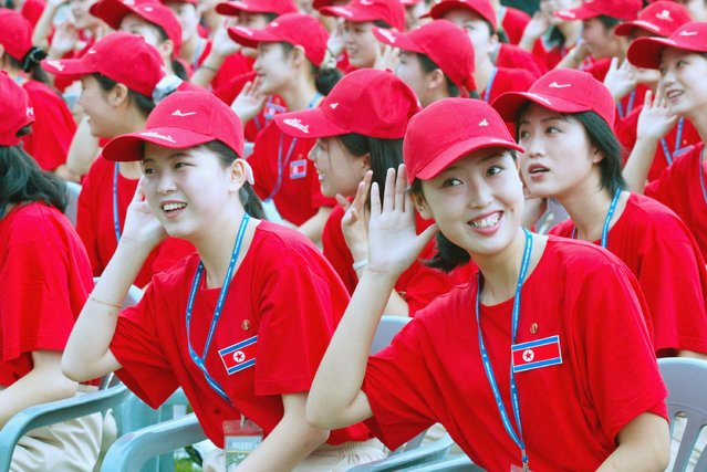 North Koreans gesture during a welcome ceremony at the World Student Games August 21, 2003 in Daegu, South Korea. North Korea and South Korea have agreed, in principle, to field a unified team for next years Olympic Games in Athens, Greece. (Photo by Chung Sung-Jun/Getty Images)