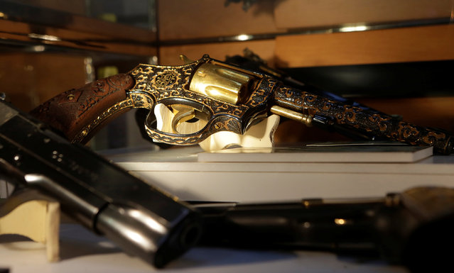 Guns decorated with gold are displayed in the Drugs Museum, used by the military to showcase to soldiers the lifestyles of Mexican drug lords, at the headquarters of the Ministry of Defense in Mexico City, October 14, 2016. (Photo by Henry Romero/Reuters)