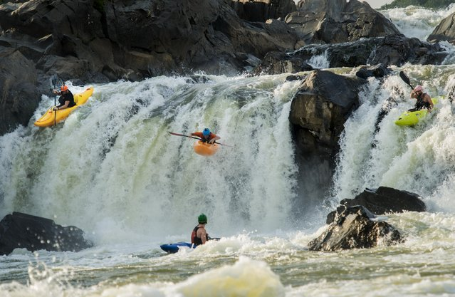 (L-R) Geoffe Calhoun, Robert Waldron, and Rich Hardy, part of a community of kayakers, trains on the rapids of Great Falls on the Potomac River in preparation for the July 5th Great Falls Race 2015 in Potomac, Maryland Friday, June 27, 2014. (Photo by Melina Mara/The Washington Post)