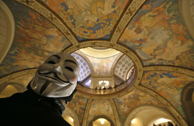 Jefferson City, Missouri: A protester wears a Guy Fawkes mask during a demonstration against police violence and the shooting of Michael Brown inside the Rotunda at the State Capitol Building in Jefferson City, Missouri December 5, 2014. (Photo by Jim Young/Reuters)