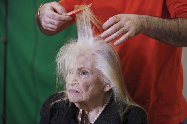 Sarah Israel, 85, a Holocaust survivor, has her hair done during preparations ahead of a beauty contest for survivors of the Nazi genocide in the northern Israeli city of Haifa, November 24, 2015. (Photo by Amir Cohen/Reuters)
