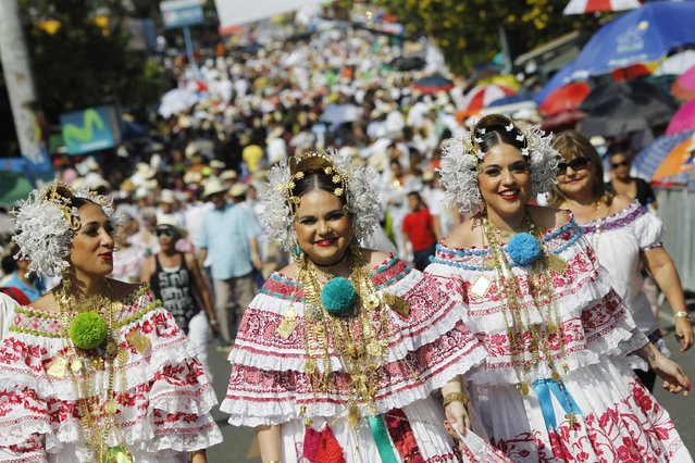 "Women wearing traditional clothing known as ""Pollera"" take part in the annual Thousand Polleras parade in Las Tablas, in the province of Los Santos January 10, 2015. (Photo by Carlos Jasso/Reuters)"