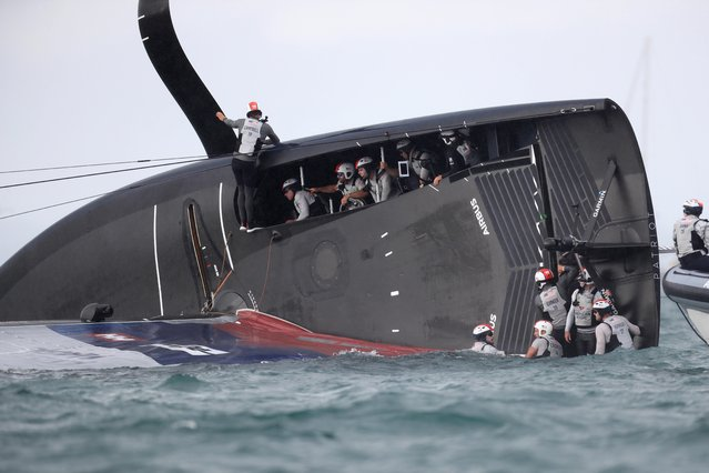 New York Yacht Club American Magic is capsized during Round Robin two, Race three against Luna Rossa Prada Pirelli of the Prada Cup 2021, the challengers series of the 36th America's Cup in Auckland on January 17, 2021. (Photo by Gilles Martin-Raget/AFP Photo)
